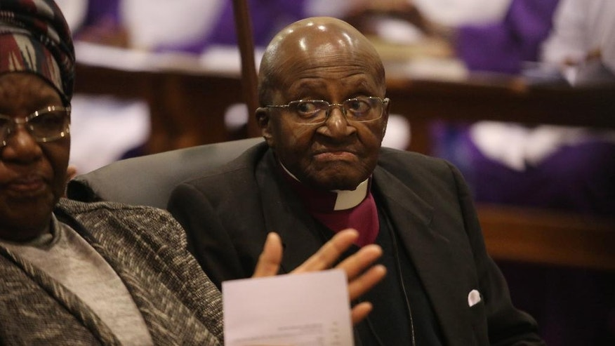 Anglican Archbishop Emeritus Desmond Tutu and his wife Leah take part in a Mass as he celebrates four decades of episcopal ministry at a special thanksgiving Mass at St Mary's Cathedral in Johannesburg, Sunday July 10, 2016. Tutu served as Dean of St Mary's prior to being appointed Bishop of Lesotho 40 years ago and was instrumental in ending apartheid in the country. (AP Photo/Denis Farrell)