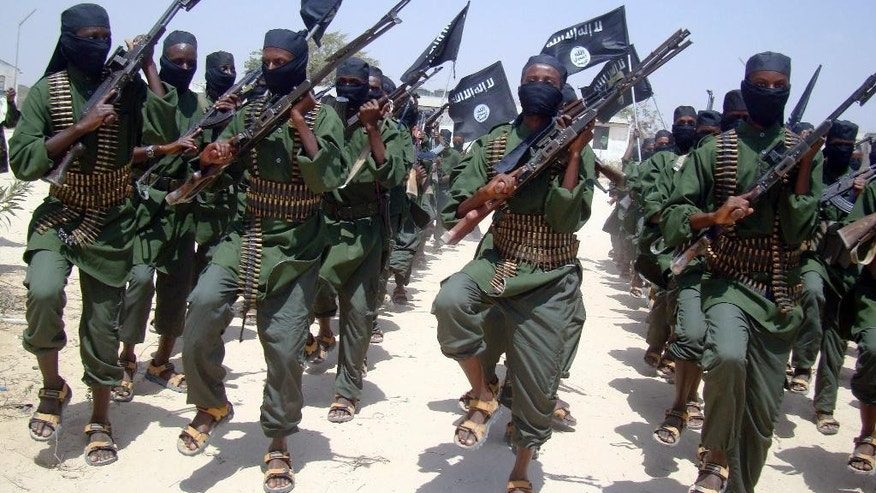 Al-Shabab fighters marching with their weapons.
