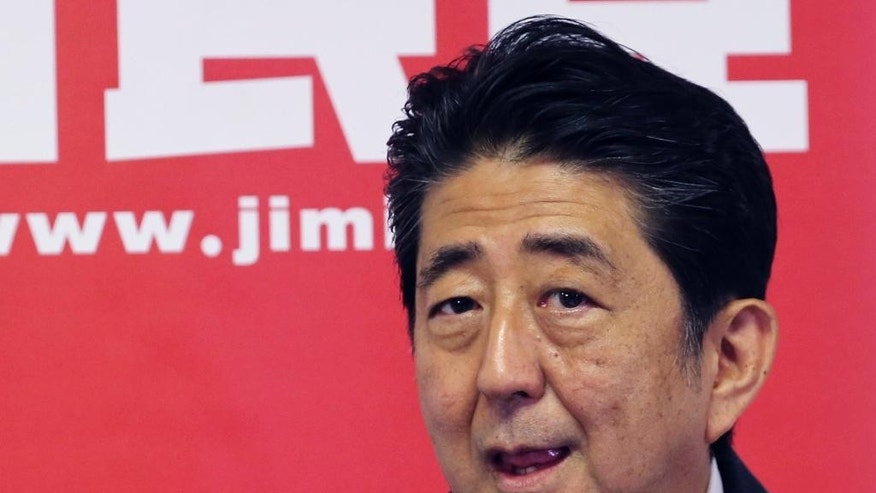Japanese Prime Minister and leader of the ruling Liberal Democratic Party, Shinzo Abe, attends a press conference in Tokyo, Monday, July 11, 2016. A resounding election victory for Abe's ruling bloc has opened the door a crack for his long-cherished ambition to revise the constitution for the first time since it was enacted in 1947 - a behind-the-scenes agenda that could over time change Japan's future. (AP Photo/Koji Sasahara)