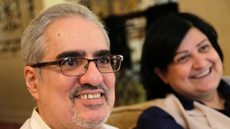 FILE -- In this June 20, 2015 file photo, Bahraini Sunni Muslim opposition leader Ibrahim Sharif, who led the secular opposition WAAD (National Democratic Action Society) group, sits with his wife Farida Ghulam at their home, in Tubli, Bahrain. The Bahrain Institute for Rights and Democracy, a Bahraini rights group, said political activist Ibrahim Sharif has been freed from prison Monday, July 11, 2016, after serving a yearlong sentence over comments he made last year. The rights group said Sharif was released but is at risk of being arrested again because of an appeal by prosecutors, who are seeking an extended sentence. (AP Photo/Hasan Jamali, File)