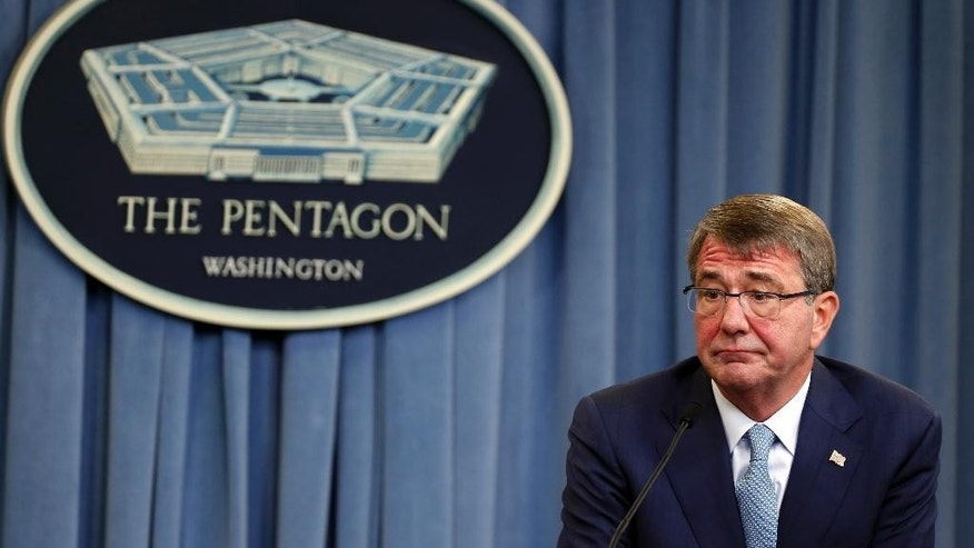 FILE - In this Thursday, June 30, 2016 file photo, Secretary of Defense Ash Carter listens to a reporter's question as he speaks during a media availability at the Pentagon in Washington. U.S. and coalition forces will use the newly retaken air base in Qayara as a staging hub, as Iraqi security forces move forward in the long-awaited battle to recapture Mosul from Islamic State militants, Carter said Monday, July 11, as he arrived in Iraq. (AP Photo/Alex Brandon, File)
