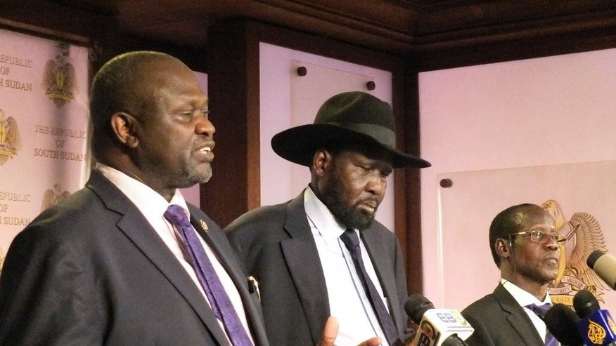 In this photo dated Friday July 8 2016, South Sudan Riek Machar, left. Salva Kiir, South Sudan President, and James Wani Igga, Vice president during a press conference at Presidential palace in Juba, South Sudan, after fighting started erupted when a group of unidentified soldiers tried to enter the palace.  Heavy explosions are shaking South Sudan's capital Juba Monday July 11, 2016 as clashes between government and opposition forces entered their fifth day, witnesses say, seeming to push the country back toward civil war. (AP Photo/Samir Bo)