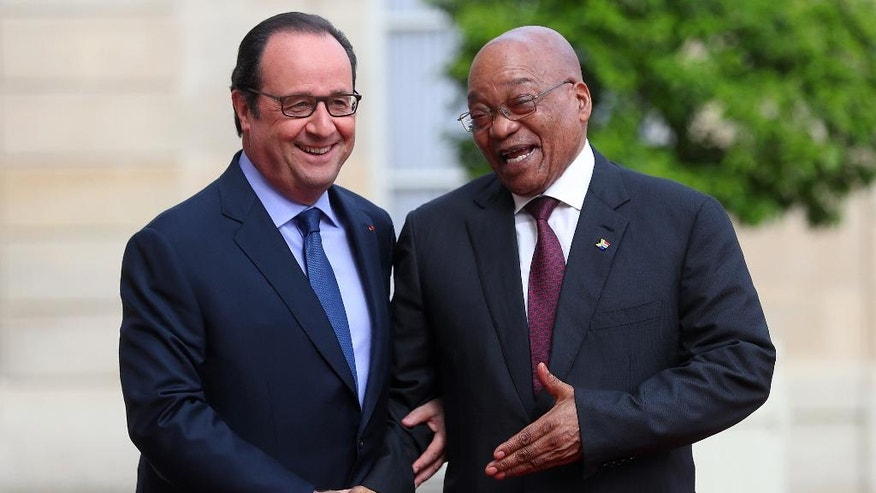 France's President Francois Hollande, left, shakes hands with South African President Jacob Zuma during a state visit, at the Elysee Palace, in Paris, Monday, July 11, 2016. Zuma is on two days official state visit to France. (AP Photo/Thibault Camus)
