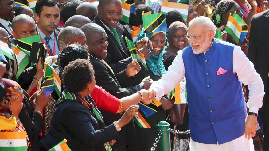 FILE - In this July 10, 2016, file photo, Indian Prime Minister Narendra Modi greets Tanzanians during an official welcome ceremony Sunday, July 10, 2016. Modi signed a number of trade agreements with Tanzania during the visit. (AP Photo/Khalfan Said, File)