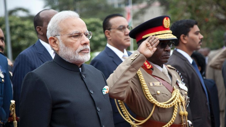 Indian Prime Minister Narendra Modi, left, listens to national anthems at Kenyan Parliament where he arrived to lay a wreath at the mausoleum of Kenya founding President Mzee Jomo Kenyatta, Monday, July 11, 2016, in Nairobi, Kenya. Modi is on two days official state visit to Kenya, after visiting Mozambique, South Africa and Tanzania. (AP Photo/Sayyid Abdul Azim)