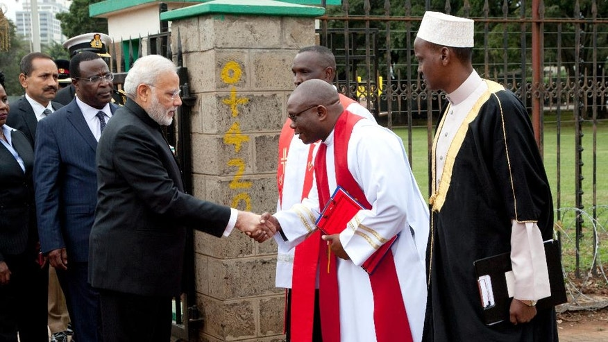 Indian Prime Minister Narendra Modi shakes hands with s religious leader after laying a wreath at the mausoleum of Kenyan founding President Mzee Jomo Kenyatta, Monday, July 11, 2016, in Nairobi, Kenya. Modi is on two days official state visit to Kenya, after visiting Mozambique, South Africa and Tanzania. (AP Photo/Sayyid Abdul Azim)