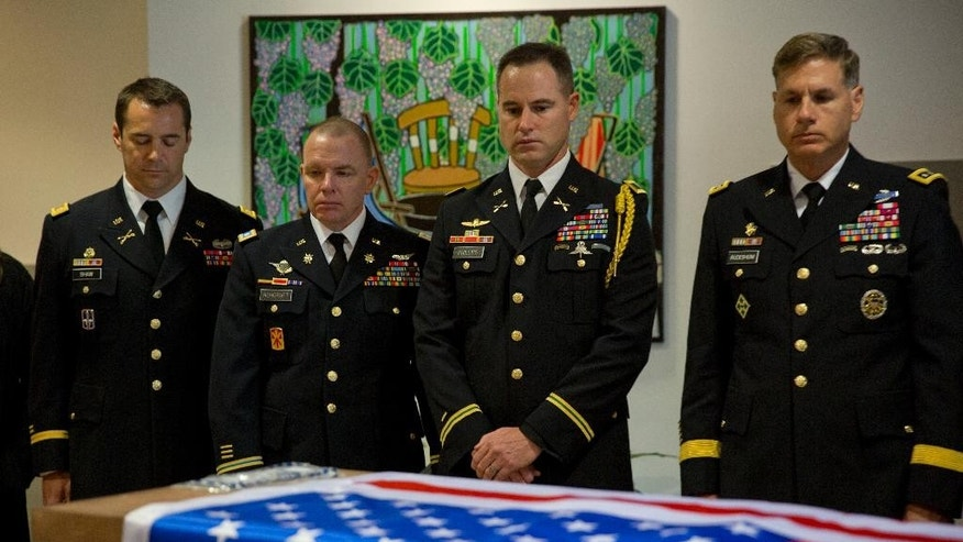 "FILE --  In this March 11, 2016 file photo, US military officers stand around the coffin of American Taylor Force, a 28-year-old MBA student at Vanderbilt University and a West Point graduate, who was killed in a stabbing attack, during a private ceremony, at Ben Gurion airport, near Tel Aviv, Israel. An Israeli rights group said Monday, July 11, 2016 that five families of victims of Palestinian attacks, including the family of Force, are suing Facebook, alleging the social network has provided militants with a platform for spreading incitement. The Shurat Hadin group says it's representing the families in the $1 billion lawsuit that claims Facebook is violating the U.S. Anti-Terrorism Act by providing a service to militant groups that helps them in ""recruiting, radicalizing, and instructing terrorists.""  (AP Photo/Ariel Schalit, File)"