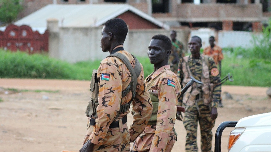 South Sudanese policemen and soldiers standing guard as fighting escalates in Juba.