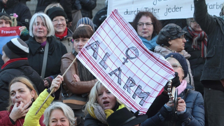 FILE - In this Jan. 9, 2016 file photo participants of a women's flash mob demonstrate against racism and sexism in Cologne, Germany in the aftermath of a string of New Year's Eve sexual assaults and robberies.