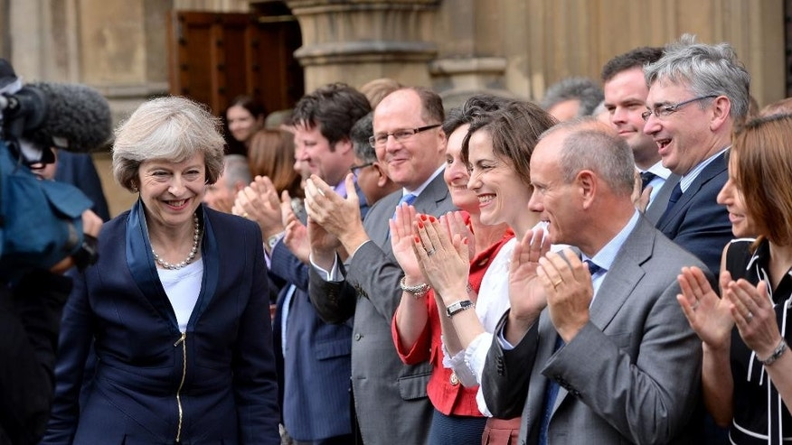 "Britain's Theresa May, left, is applauded by Conservative Party members of parliament outside the Houses of Parliament in London, Monday July 11, 2016. Britain's Conservative Party has confirmed that Theresa May has been elected party leader ""with immediate effect"" and will become the country's next prime minister. Prime Minister David Cameron has said he will step down on Wednesday July 13, 2016 and May will immediately replace him. (Dominic Lipinski/PA via AP)"