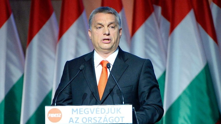 FILE - In this Dec. 13 , 2015 file photo Hungarian Prime Minister and Chairman of the Fidesz, Hungarian Civic Alliance, Viktor Orban , delivers his speech after he was re-elected as party chairman in Budapest, Hungary,  The refugee crisis and the threat of terrorism in Europe are very much related to one another in the minds of many Europeans, according to a survey conducted  by the Pew Research Center across the continent. Many Europeans also worry that migrants will become an economic burden and take away their jobs and social benefits. Populist parties all over the continent have successfully increased their numbers by campaigning against Muslim migrants including the right-wing Alternative for Germany or Austria's Freedom Party.   (Tamas Kovacs/MTI via AP,file)