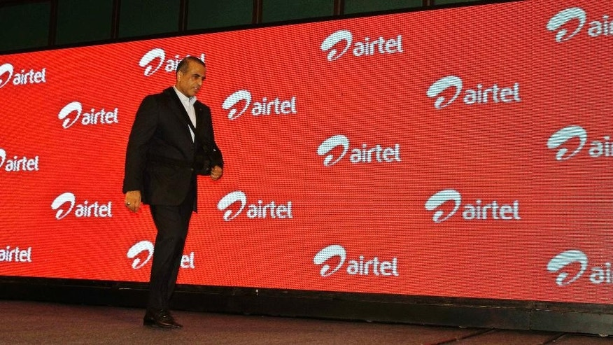 FILE- In this Tuesday, April 10, 2012, file photo, Bharti Airtel Ltd. Chairman and Managing Director Sunil Mittal walks as he attends a press conference during launch of Airtel's 4G services, in Kolkata, India. India has the most transparent companies while Chinese firms are the most opaque, according to a global anti-graft watchdog's survey released Monday that assesses efforts by emerging market companies to fight corruption. Indian Telecom company Bharti Airtel took first place with a score of 7.3 out of 10. (AP Photo/Bikas Das, File)