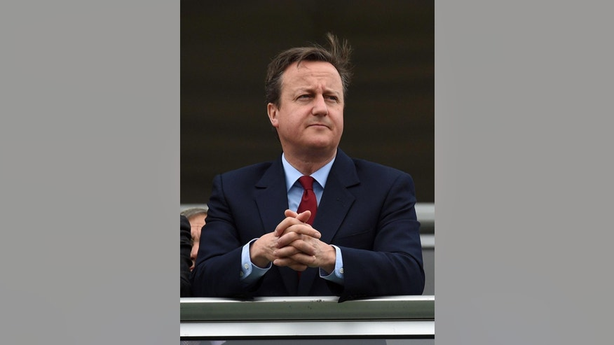 Britain's Prime Minister David Cameron attends the Farnborough International Airshow in Farnborough, England, Monday July 11, 2016. Andrea Leadsom, one of two Conservative lawmakers vying to replace Prime Minister David Cameron, withdrew from the contest Monday, leaving Home Secretary Theresa May as the sole remaining candidate. (Andrew Matthews/PA via AP)