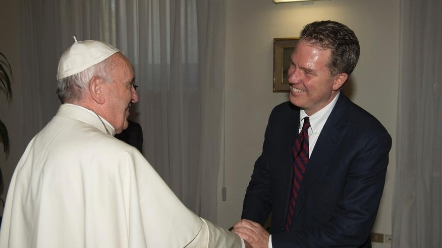 Pope Francis shakes hands with Greg Burke at the Vatican, Monday, July 11, 2016. The pontiff has named a former Fox TV correspondent, Greg Burke, to replace his longtime spokesman and tapped Paloma Garcia Ovejero, of Spain, to be his deputy, the first time a woman has held the post. (L'Osservatore Romano/Pool photo via AP)
