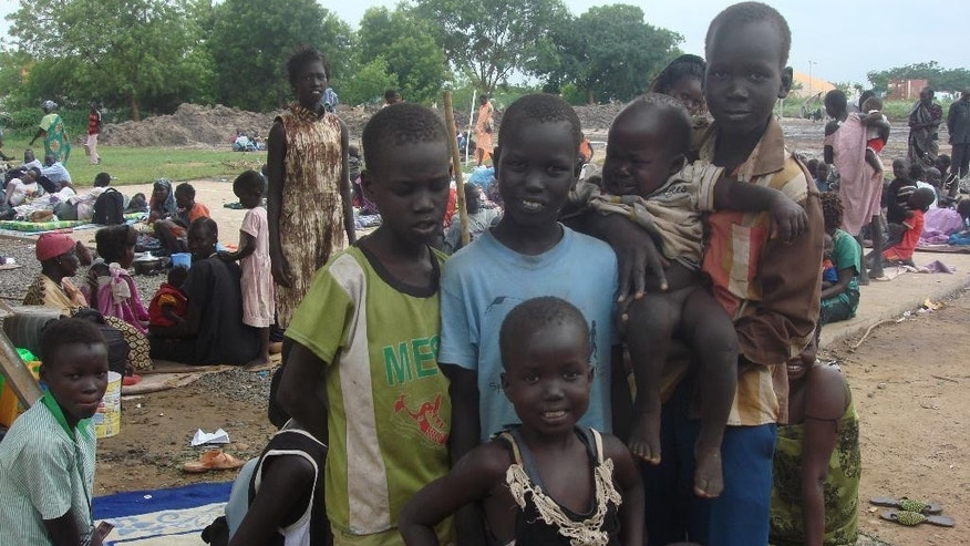 In this photo provided by UNMISS , children pose for a photograph, in Juba, South Sudan at the UN compound in the Tomping area, Tuesday, July 12, 2016. An uneasy calm settled over South Sudan's capital on Tuesday after the country's leader and his top rival both demanded a cease-fire. Renewed fighting between opposing army forces has raised fears of a return to civil war in the East African country, which marked its fifth anniversary of independence over the weekend while panicked residents hid inside their homes. A look at the situation for the nation's estimated 12 million people. (Beatrice Mategwa/UNMISS via AP)