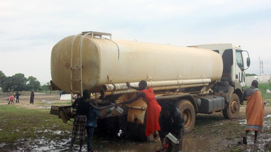 A woman fills water from a UN tanker in Juba, South Sudan at the UN compound in the Tomping area, Tuesday, July 12, 2016. An uneasy calm settled over South Sudan's capital on Tuesday after the country's leader and his top rival both demanded a cease-fire. Renewed fighting between opposing army forces has raised fears of a return to civil war in the East African country, which marked its fifth anniversary of independence over the weekend while panicked residents hid inside their homes. A look at the situation for the nation's estimated 12 million people. (Beatrice Mategwa/UNMISS via AP)