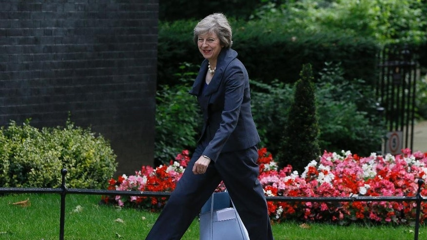 Britain's Home Secretary Theresa May arrives to attend a cabinet meeting at 10 Downing Street, in London, Tuesday, July 12, 2016. Theresa May will become Britain's new Prime Minister on Wednesday. (AP Photo/Kirsty Wigglesworth)