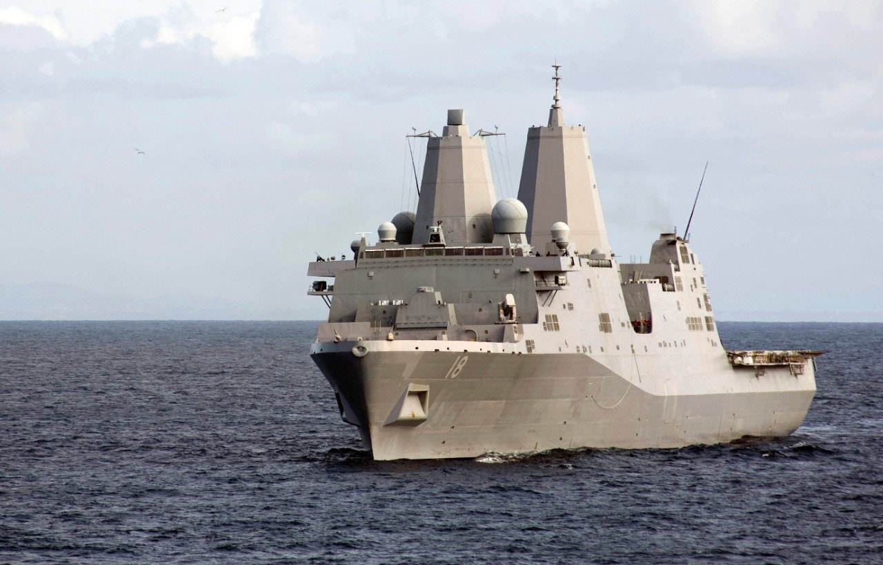 Iranian military boats veer dangerously close to US warship
