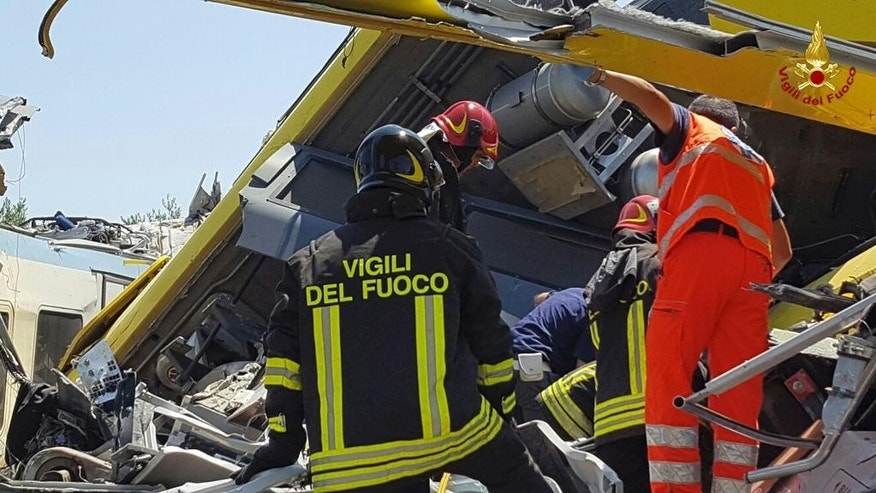 Italian firefighters Vigili del Fuoco inspect the wreckage of two commuter trains after their head-on collision in the southern region of Puglia, killing several people, Tuesday, July 12, 2016.  (Italian Firefighter Press Office via AP)