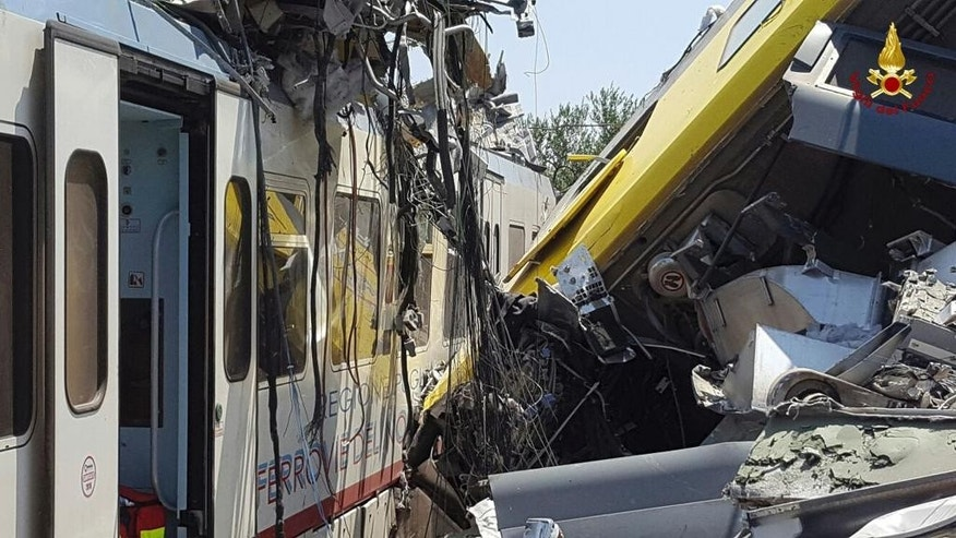 Crumpled wagon cars are seen after after two commuter trains collided head-on near the town of Andria, in the southern region of Puglia, killing several people, Tuesday, July 12, 2016.  (Italian Firefighter Press Office via AP)