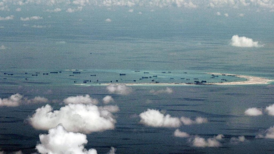 FILE - This May 11, 2015, file photo, shows land reclamation of Mischief Reef in the Spratly Islands in the South China Sea. An international tribunal has found that there is no legal basis for China's claiming rights to much of the South China Sea. The Permanent Court of Arbitration (PCA) issued its ruling Tuesday, July 12, 2016, in The Hague in response to an arbitration case brought by the Philippines against China regarding the South China Sea, saying that any historic rights to resources that China may have had were wiped out if they are incompatible with exclusive economic zones established under a U.N. treaty. (Ritchie B. Tongo/Pool Photo via AP, File)
