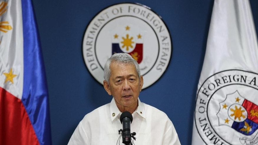"Philippines Foreign Affairs Secretary Perfecto Yasay Jr. issues a statement on the recent ruling in a long-running dispute between the Philippines and China over the South China Sea during a press conference in suburban Pasay, south of Manila, Philippines on Tuesday, July 12, 2016. An international tribunal has found that there is no legal basis for China's ""nine-dash line"" claiming rights to much of the South China Sea. The tribunal issued its ruling Tuesday in The Hague in response to an arbitration case brought by the Philippines against China. (AP Photo/Aaron Favila)"