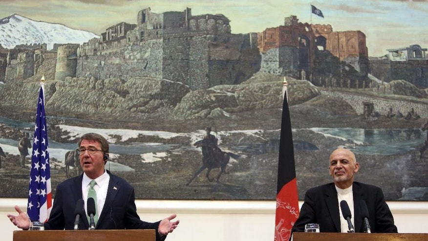 U.S. Secretary of Defense Ash Carter, left, speaks as Afghan President Ashraf Ghani, right, listens during  press conference at the Presidential Palace in Kabul, Afghanistan, Tuesday, July 12, 2016. (AP Photo/Rahmat Gul)