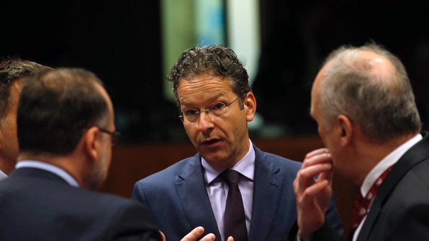 Dutch Finance Minister and chair of the eurogroup finance ministers Jeroen Dijsselbloem, center, speaks with other ministers at the start of the Economic and Financial Affairs Council meeting at the EU Council building in Brussels, Belgium, Tuesday, July 12, 2016. (AP Photo/Darko Vojinovic)