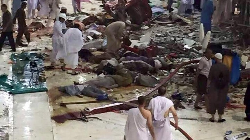 File -- In this Sept. 11, 2015 file photo, pilgrims and first responders gather at the site of a crane collapse that killed dozens inside the Grand Mosque in Mecca, Saudi Arabia. A state-linked Saudi newspaper reported Tuesday, July 12, 2016 that charges, followed by a trial, are due soon over the crane collapse in Mecca that killed 111 pilgrims and injured nearly 240 people ahead of the start of last year's annual hajj pilgrimage. It was the first of two major tragedies to mar the hajj. Just days later, a stampede and crush of pilgrims killed more than 2,400 people on Sept. 24, according to an Associated Press count. (AP Photo, File)