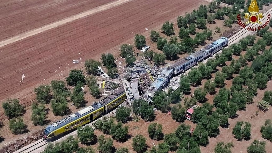 This aerial handout photo shows what is left of two commuters trains after their head-on collision in the southern region of Puglia, Tuesday, July 12, 2016. At least 10 people died and several others are reported injured. (Italian Firefighter Press Office via AP)