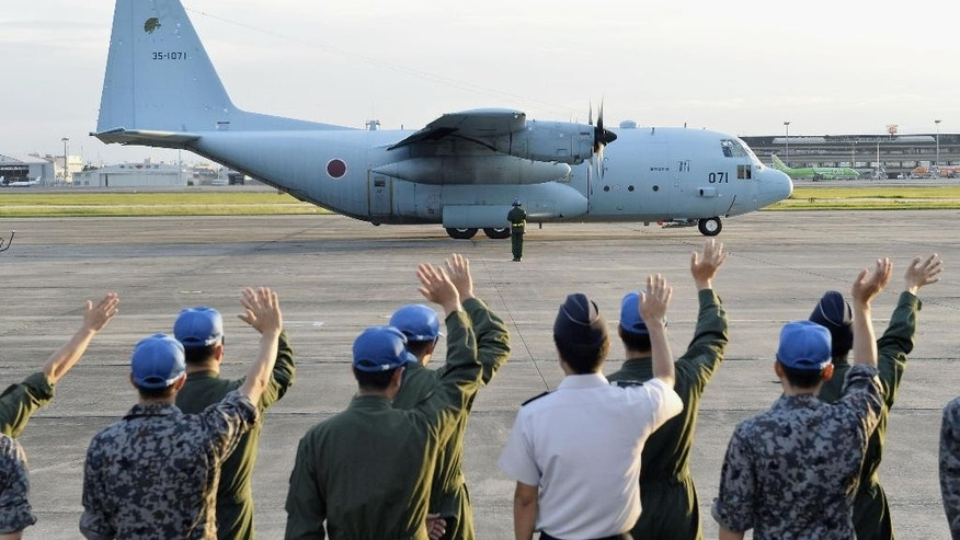 In this Monday, July 11, 2016 photo, a Japan Air Self-Defense Force C-130 transport plane takes off from Komaki Base in Komaki, Aichi Prefecture, central Japan, for South Sudan.  Japan has urged dozens of Japanese nationals including aid agency workers in South Sudan's capital of Juba to leave the country and dispatched military aircraft for evacuation amid renewed fighting in the African nation.   (Yoshiaki Sakamoto/Kyodo News via AP)