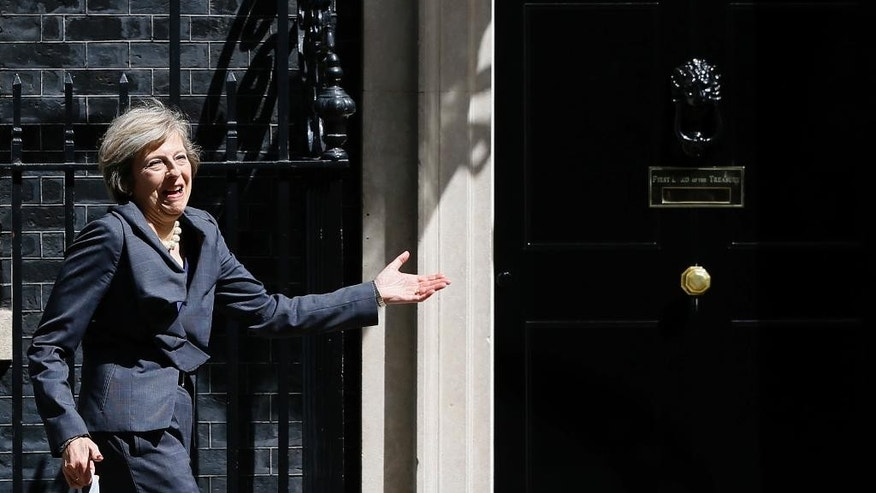 Britain's Home Secretary Theresa May gestures as she leaves after attending a cabinet meeting at 10 Downing Street, in London, Tuesday, July 12, 2016. Theresa May will become Britain's new Prime Minister on Wednesday. (AP Photo/Kirsty Wigglesworth)