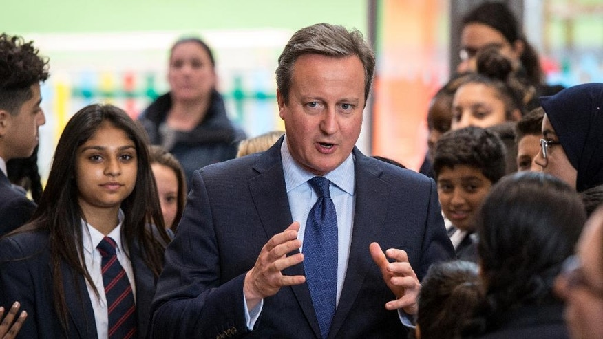 Britain's Prime Minister David Cameron talks to pupils during a visit to Reach Academy Feltham in south west London, Tuesday July 12, 2016. British Prime Minister David Cameron chaired a farewell Cabinet meeting Tuesday before handing over power to his successor following the historic vote to leave the European Union. Ministers gathered for the final session a day after Home Secretary Theresa May was confirmed as the new Conservative leader and prime minister-in-waiting. (Chris J. Ratcliffe/Pool via AP)