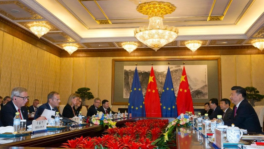 European Commission President Jean-Claude Juncker, left, and European Council President Donald Tusk, second from left, hold talks with Chinese President Xi Jinping, right, during a meeting at the Diaoyutai State Guesthouse in Beijing Tuesday, July 12, 2016. (AP Photo/Ng Han Guan, Pool)