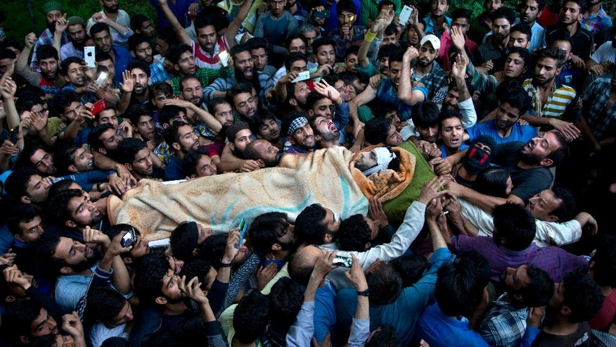 FILE- In this July 9, 2016 file photo, Kashmiri villagers carry the body of Burhan Wani, chief of operations of Indian Kashmir's largest rebel group Hizbul Mujahideen, during his funeral procession in Tral, some 38 Kilometers (24 miles) south of Srinagar, Indian controlled Kashmir. When Indian forces gleefully announced last week that they had killed a top Kashmiri rebel leader, they called it a major victory in the fight against militants in the disputed Himalayan region. They clearly didn't expect the backlash that followed - an outpouring of public anger, daily protests and dozens dead in the streets. (AP Photo/Dar Yasin, File)