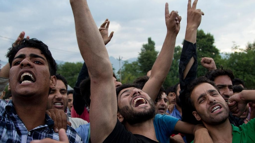 FILE- In this July 9, 2016 file photo, Kashmiri villagers shout slogans during the funeral procession of Burhan Wani, chief of operations of Indian Kashmir's largest rebel group Hizbul Mujahideen, in Tral, some 38 Kilometers (24 miles) south of Srinagar, Indian controlled Kashmir. When Indian forces gleefully announced last week that they had killed a top Kashmiri rebel leader, they called it a major victory in the fight against militants in the disputed Himalayan region. They clearly didn't expect the backlash that followed - an outpouring of public anger, daily protests and dozens dead in the streets. (AP Photo/Dar Yasin, File)