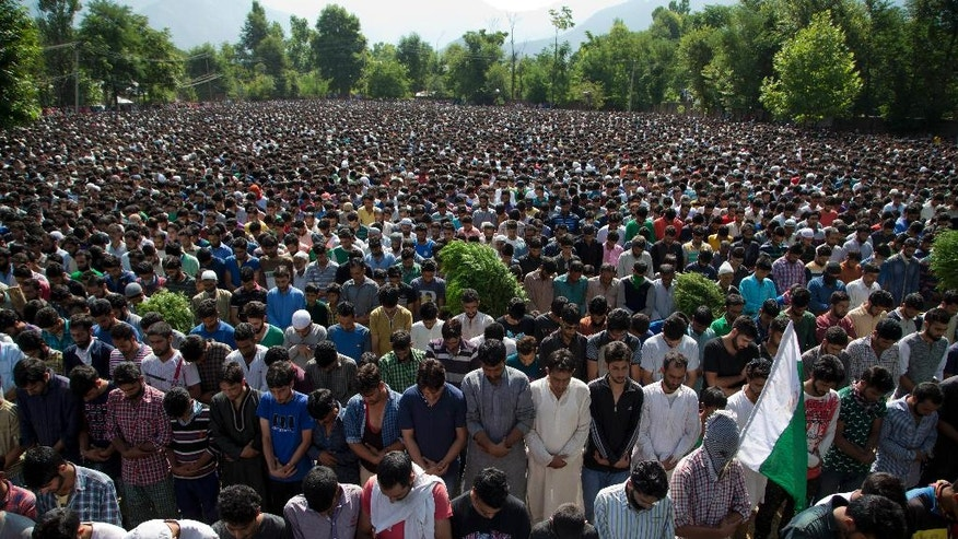 FILE- In this July 9, 2016 file photo, Kashmiri villagers pray during the funeral of Burhan Wani, chief of operations of Indian Kashmir's largest rebel group Hizbul Mujahideen, in Tral, some 38 Kilometers (24 miles) south of Srinagar, Indian controlled Kashmir. When Indian forces gleefully announced last week that they had killed a top Kashmiri rebel leader, they called it a major victory in the fight against militants in the disputed Himalayan region. They clearly didn't expect the backlash that followed - an outpouring of public anger, daily protests and dozens dead in the streets. (AP Photo/Dar Yasin, File)