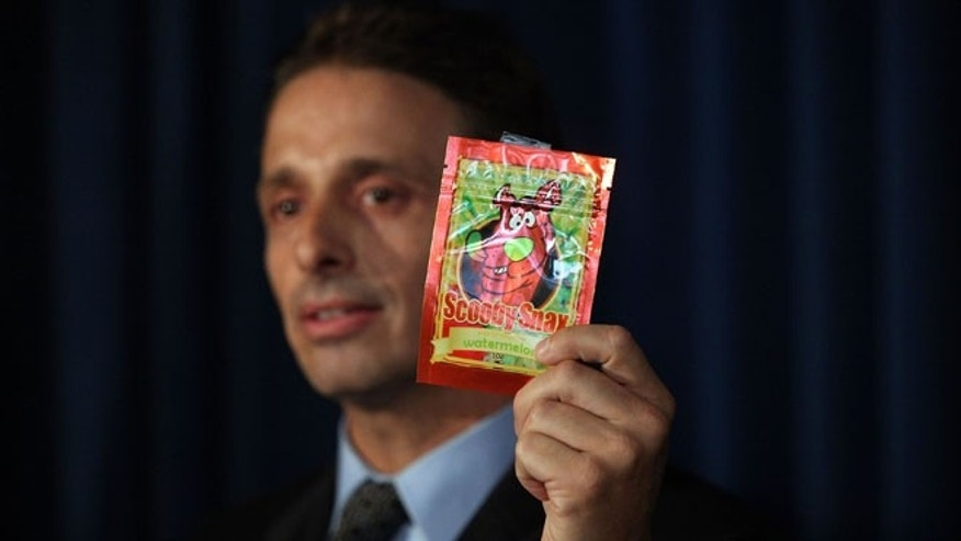 The DEA's Kieth Kruskall holds up a package of synthetic marijuana on Sept. 16, 2015 in New York City.