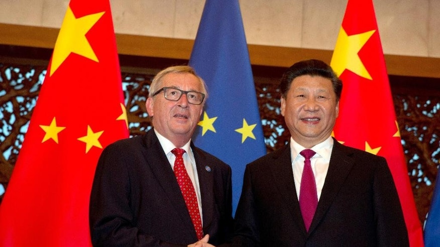 European Commission President Jean-Claude Juncker, left, and Chinese President Xi Jinping pose for a photo before a meeting at the Diaoyutai State Guesthouse in Beijing Tuesday, July 12, 2016. (AP Photo/Ng Han Guan, Pool)
