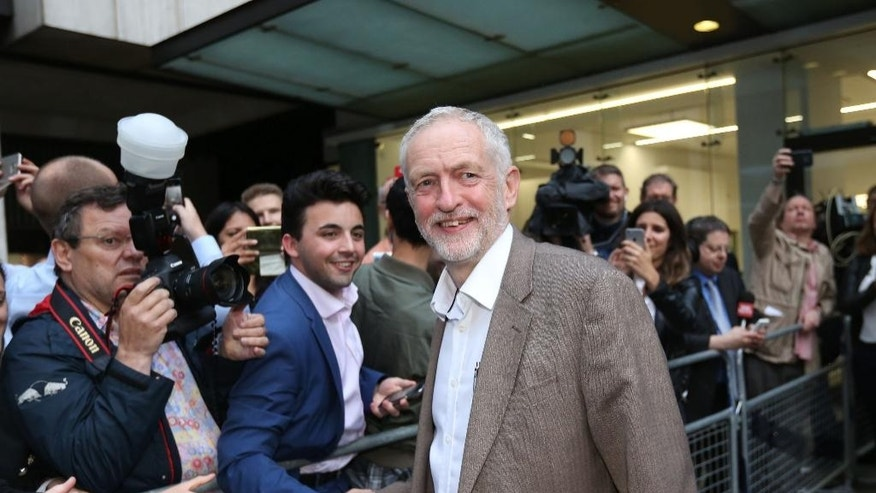 "Labour Party leader, Jeremy Corbyn, leaves Labour headquarters in Westminster, London, after the Labour National Executive Committee held a meeting about the party leadership contest, Tuesday July 12, 2016, where it was agreed to automatically include him on the ballot in the party's leadership contest. The Opposition leader said he was ""delighted"" that the secret vote went in his favour after hours of discussions. (Rick Findler/PA via AP)"