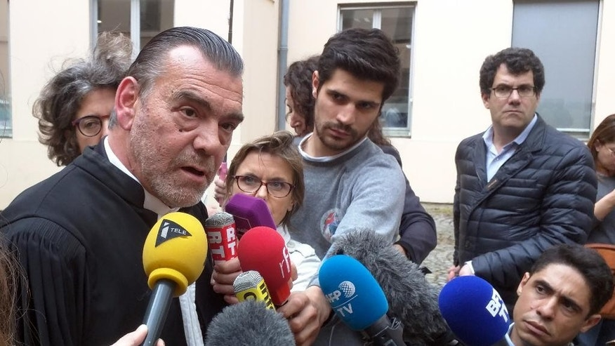 Lawyer Frank Berton, left, who represents Paris attacks suspect Salah Abdeslam, speaks to journalists outside an administrative tribunal in the Parisian suburb of Versailles, France, Wednesday, July 13, 2016. Berton is appealing to the tribunal to have two live video cameras removed from Abdeslam's cell in the French prison of Fleury-Merogis, saying they risk damaging him psychologically. (AP Photo/Raphael Satter)