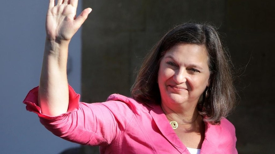 "In this Tuesday, July 12, 2016, U.S. Assistant Secretary of State for European Affairs Victoria Nuland waves to the media as she arrives for a meeting with Cypriot President Nicos Anastasiades at the Presidential palace in capital Nicosia in the ethnically divided island's. Cypriot President Nicos Anastasiades has asked US Assistant Secretary of State Victoria Nuland to convey to the Turkish side the need to resolve ""substantial disagreements"" on specific aspects of sharing power in an envisioned federation. (AP Photo/Petros Karadjias)"
