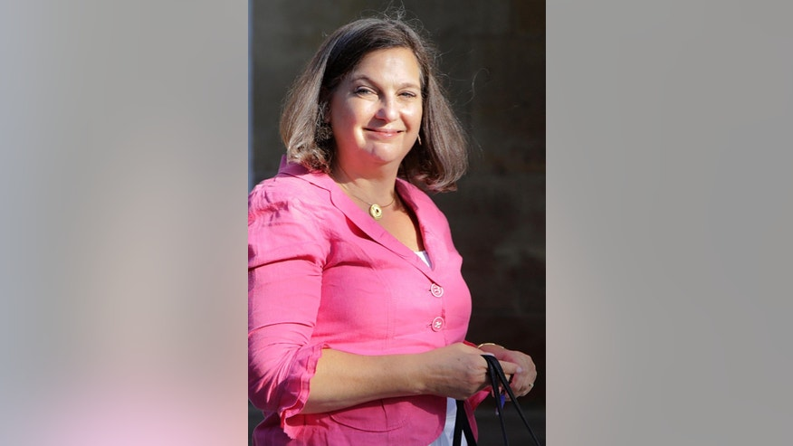 "In this Tuesday, July 12, 2016, U.S. Assistant Secretary of State for European Affairs Victoria Nuland arrives for a meeting with Cypriot President Nicos Anastasiades at the Presidential palace in capital Nicosia in the ethnically divided island's. Cypriot President Nicos Anastasiades has asked US Assistant Secretary of State Victoria Nuland to convey to the Turkish side the need to resolve ""substantial disagreements"" on specific aspects of sharing power in an envisioned federation. (AP Photo/Petros Karadjias)"
