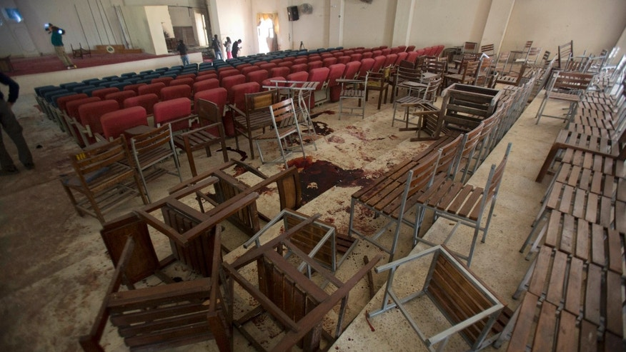 Dec. 17, 2014: Chairs are upturned and blood stains the floor at the Army Public School auditorium a day after Taliban gunmen stormed the school and killed some 150 people, mostly children, in Peshawar, Pakistan