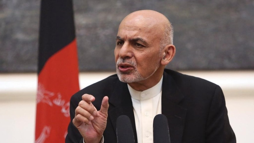 In this Tuesday, July 12, 2016 photo, Afghan President Ashraf Ghani speaks during a joint press conference with U.S. Secretary of Defense Ash Carter at the Presidential Palace in Kabul, Afghanistan. Afghan officials said a peace process aimed at ending the war with the Taliban has stalled, raising fears the violence will intensify following U.S. President Barack Obama's decision to delay cuts to American troops in the country. (AP Photo/Rahmat Gul)