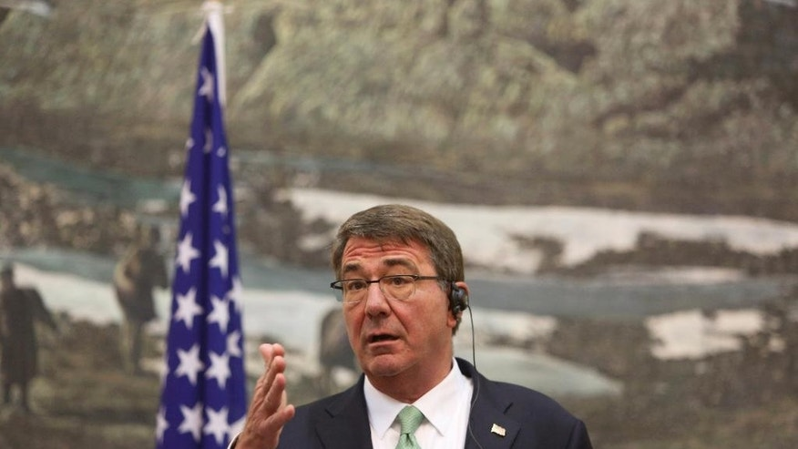 In this Tuesday, July 12, 2016. photo, U.S. Secretary of Defense Ash Carter, speaks during a joint press conference with Afghan President Ashraf Ghani, at the Presidential Palace in Kabul, Afghanistan. Afghan officials said Thursday, July 14, 2016 a peace process aimed at ending the war with the Taliban has stalled, raising fears the violence will intensify following U.S. President Barack Obama's decision to delay cuts to American troops in the country. (AP Photo/Rahmat Gul)