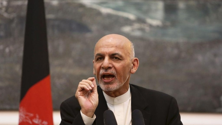 In this Tuesday, July 12, 2016 photo, Afghan President Ashraf Ghani speaks during a joint press conference with U.S. Secretary of Defense Ash Carter, at the Presidential Palace in Kabul, Afghanistan. Afghan officials said a peace process aimed at ending the war with the Taliban has stalled, raising fears the violence will intensify following U.S. President Barack Obama's decision to delay cuts to American troops in the country. (AP Photo/Rahmat Gul)
