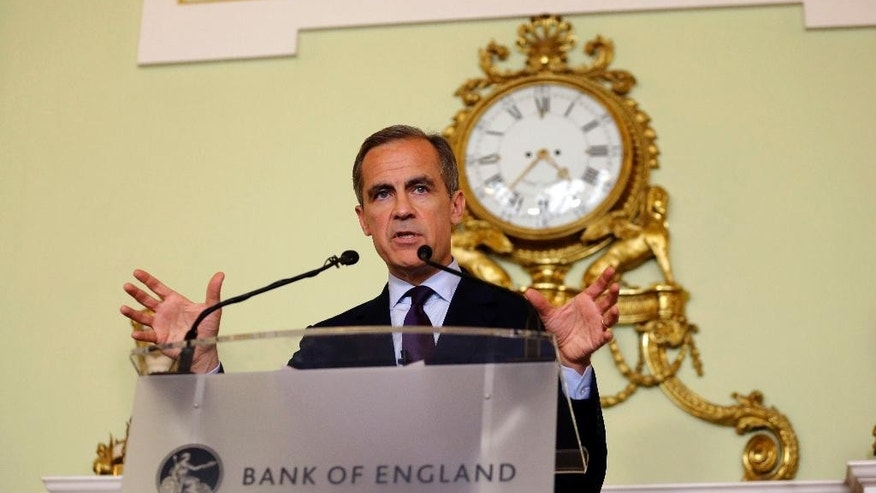 FILE - In this Thursday, June 30, 2016 file photo, The governor of the Bank of England Mark Carney gives a press conference in the City of London. The Bank of England kept interest rates on hold and refrained from injecting more money into the economy Thursday, July 14, despite concerns over the economic impact of Britain's decision to leave the European Union. (AP Photo/Matt Dunham, Pool)