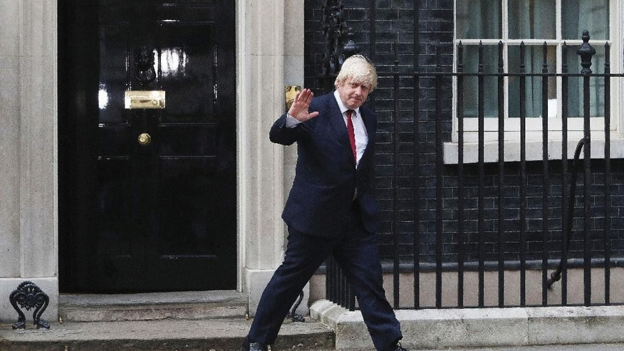 Boris Johnson leaves 10 Downing Street after being appointed Foreign Secretary, following a Cabinet reshuffle by new Prime Minister Theresa May, in London, Wednesday, July 13, 2016.  (Steve Parsons/PA via AP)