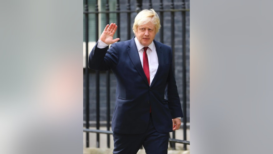 Boris Johnson leaves 10 Downing Street in central London, after being appointed Foreign Secretary, by Britain's new Prime Minister Theresa May, Wednesday July 13, 2016. (Hannah McKay/PA via AP)